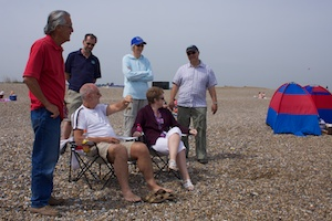 His Highness King Mike (Canute) Finch holding court on Dunwich beach with loyal(?) subjects Guy Gomes, Eric, Marion Browning, Tracy Finch and Paul Browing.